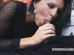 Black-haired woman satisfied on sofa with black manhood