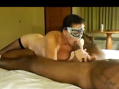 Masked hotwife worships her bull's big black cock